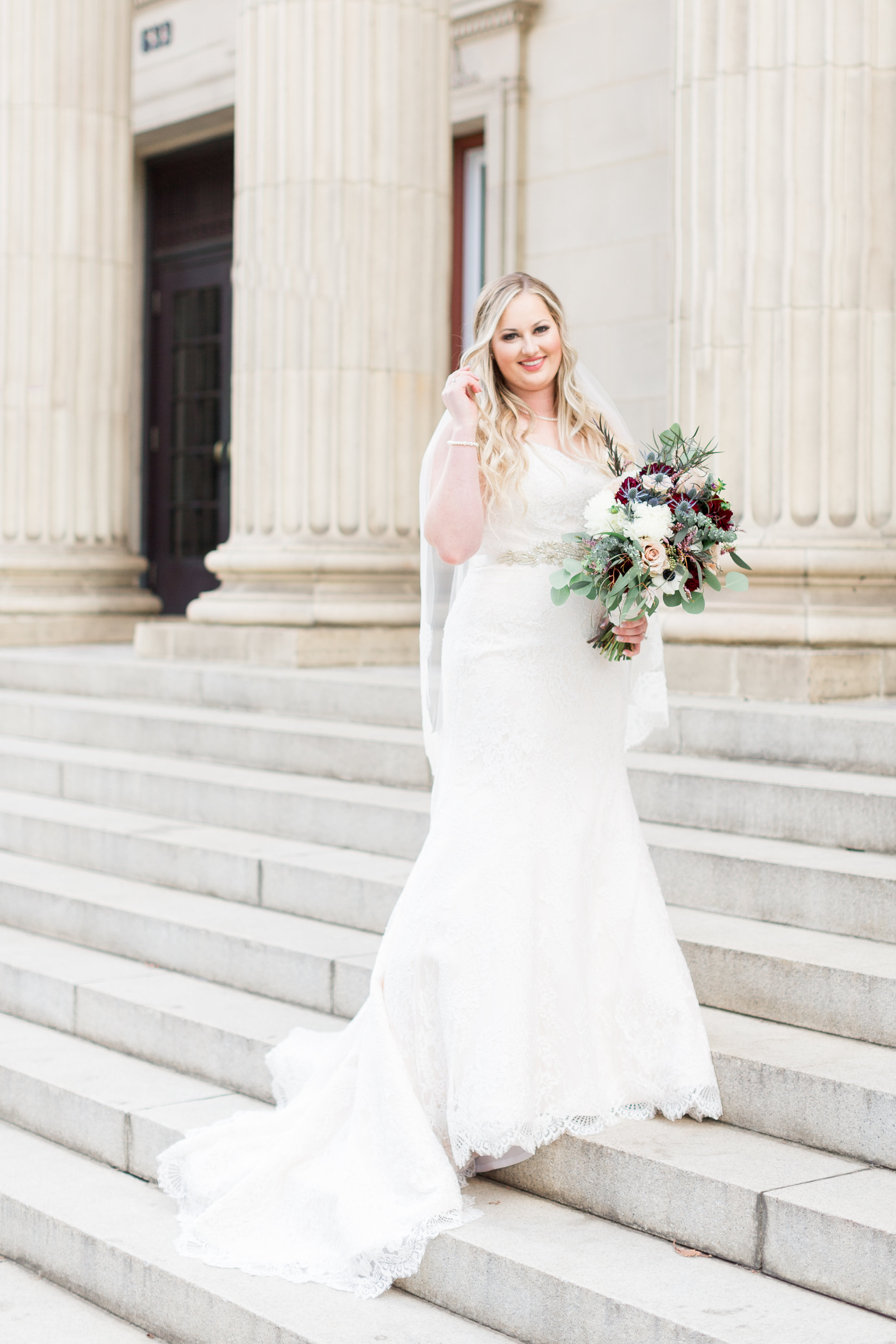 bride-takes-solo-photos-in-front-of-sf-city-hall-wedding(3 of).jpg