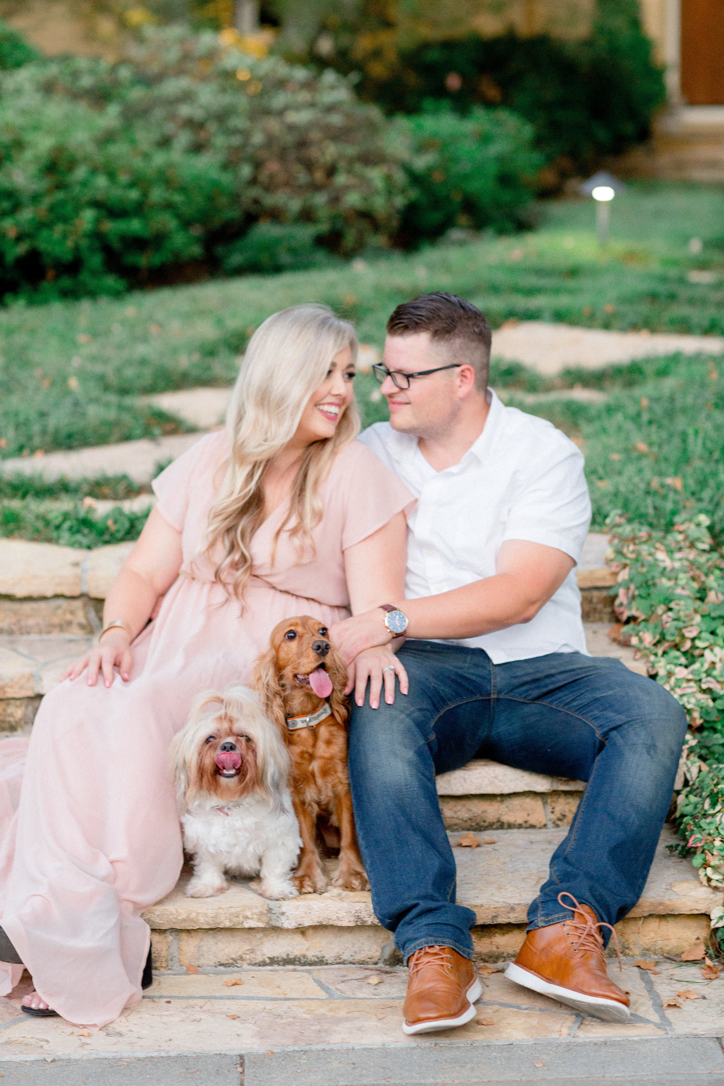 engaged-couple-takes-photos-with-their-dogs.jpg