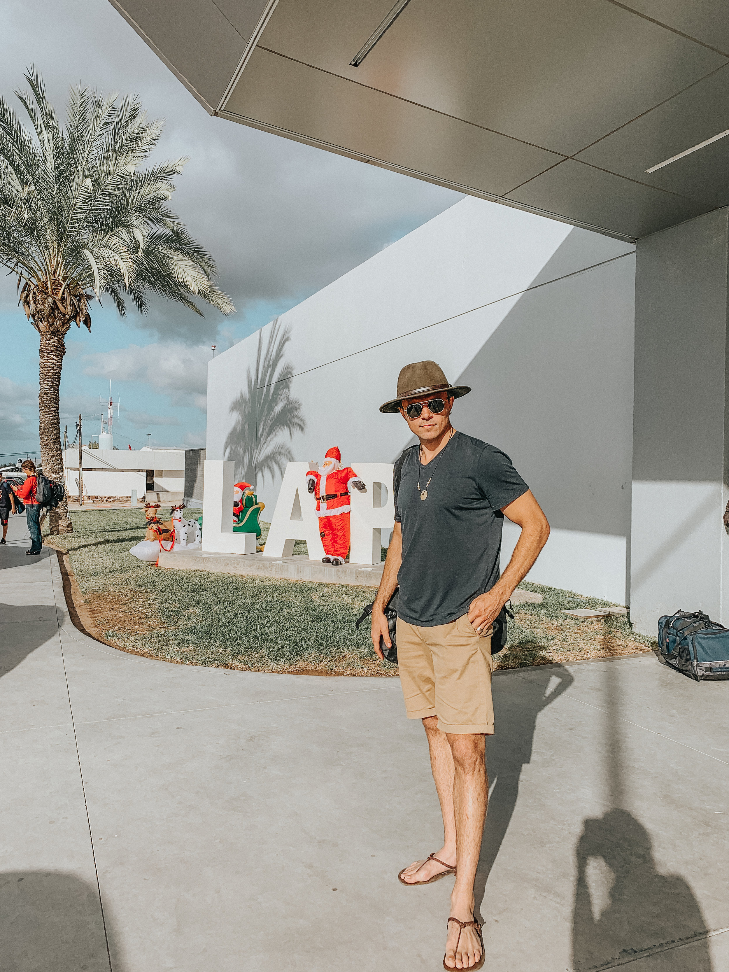 Josh, Santa, and my shadow at the La Paz airport.