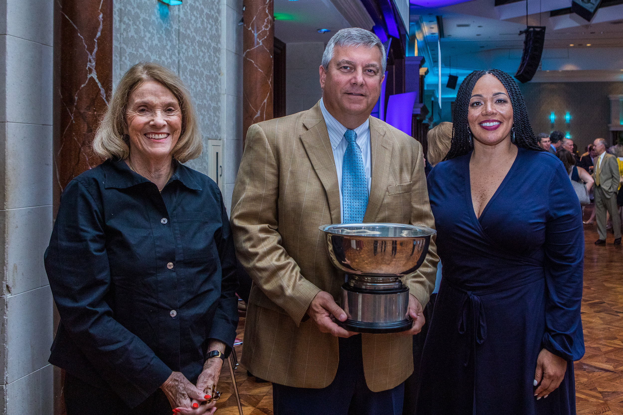 Mrs. Jackie Humphrey and Superintendent Sharon Contreras present Principal Jim Gibson the award at the Greensboro Chamber's State of Our Community Luncheon held Wednesday, August 28, 2019. Photo credit: Ivan Saul Cutler for Guilford County Schools