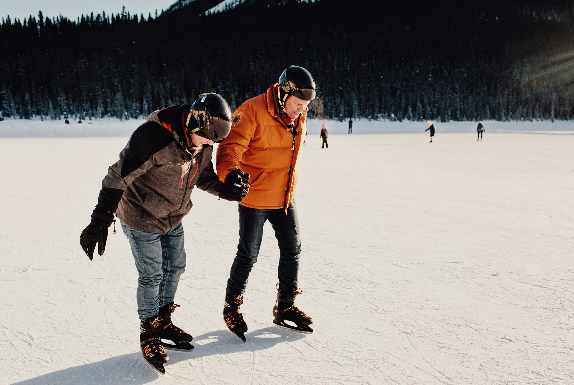 Rob Scheer and his husband Reece ice skating on Lake Louise in Alberta, Canada