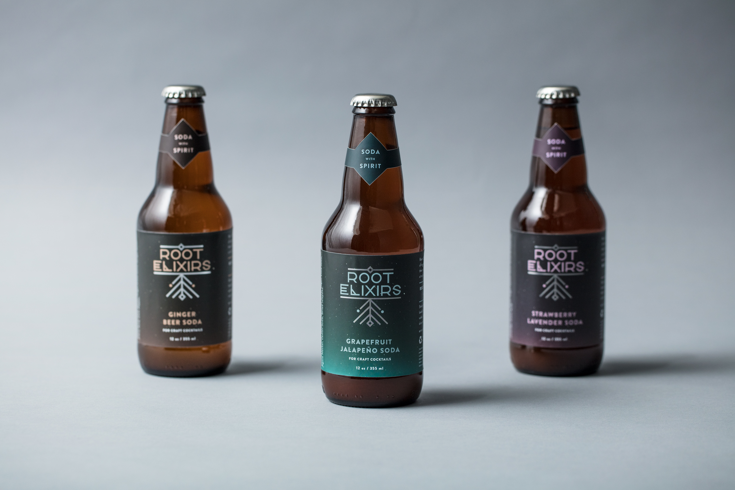 Color is used to distinguish the three flavors on labels. Silver foil on the logo elevates the product.