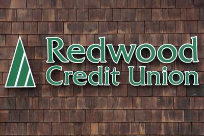 Redwood Credit Union signage on wood wall