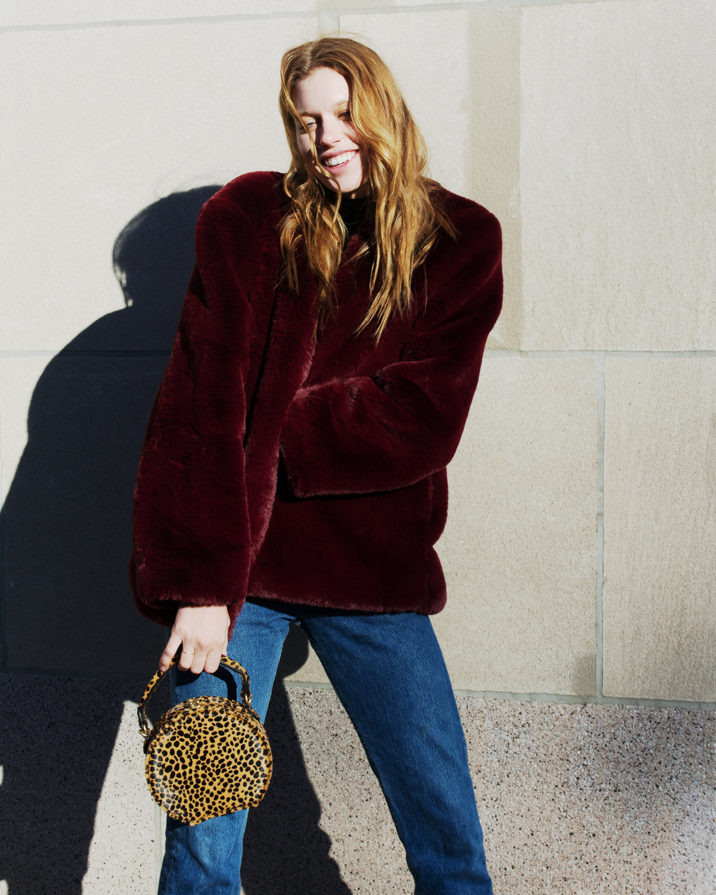 Love this little leopard bag so fun and easy to style from  Anthropologie You can also where it as a crossbody for a everyday bag.