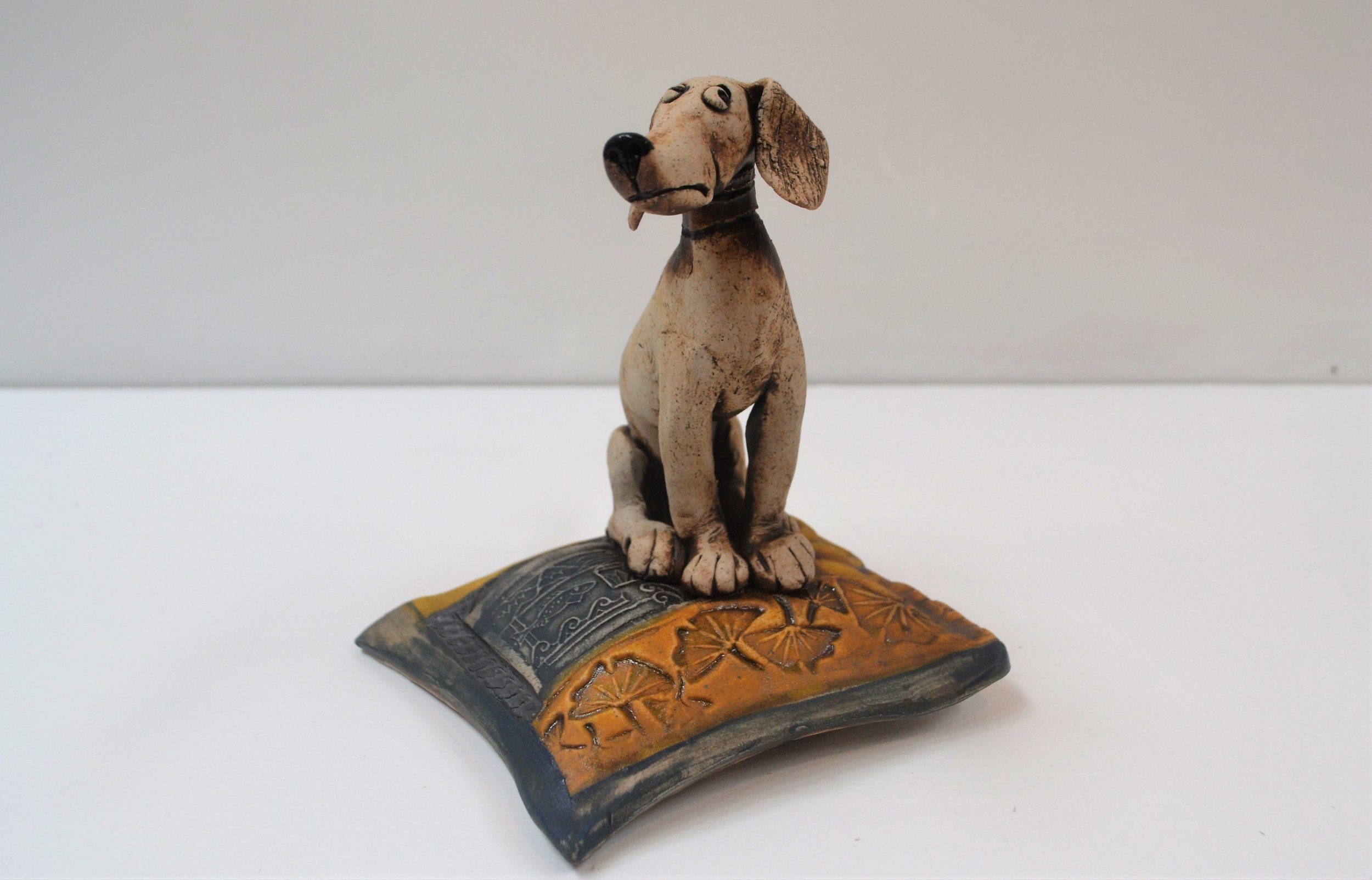 Sitting Dog on Cushion  Fiona Tunnicliffe, hand formed ceramic sculpture, 170mm height  sold
