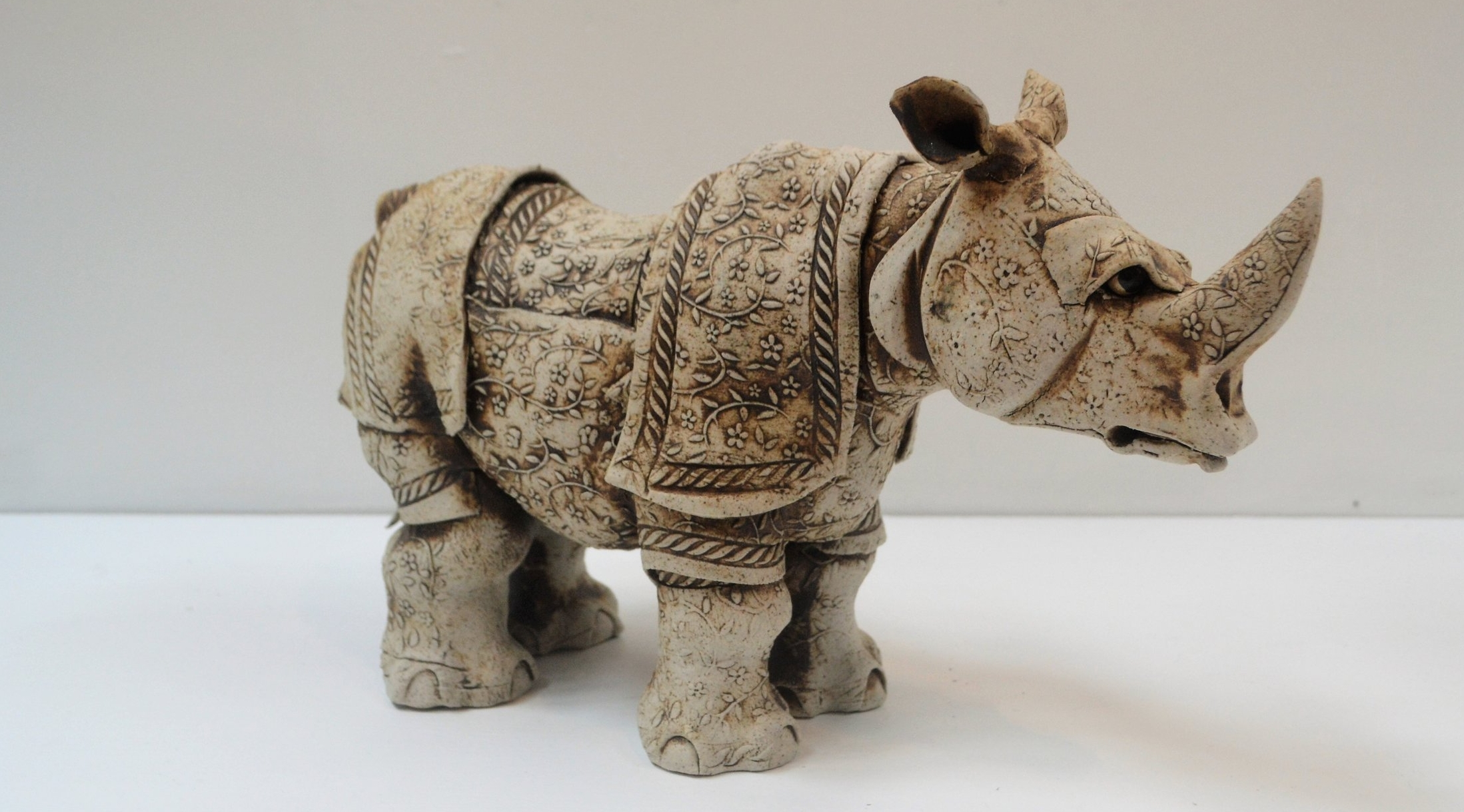 Flower Rhino  Fiona Tunnicliffe, hand formed ceramic sculpture, 200mm height  $350.00