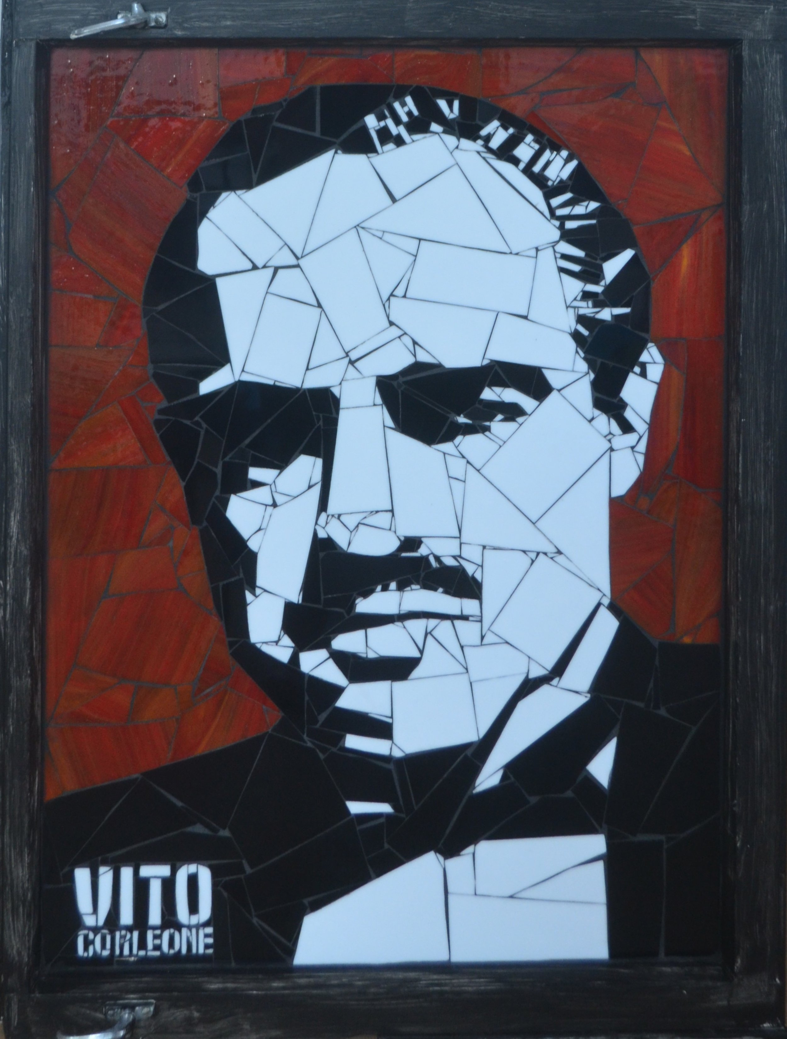 Vito Corleone  Danielle Fernandez, pop-art stained glass mosaic, sculpted on antique/distressed window pane, 910mm x 680mm. Vito Corleone was Marlon Brando's character in the classic movie The Godfather  $3,900.00