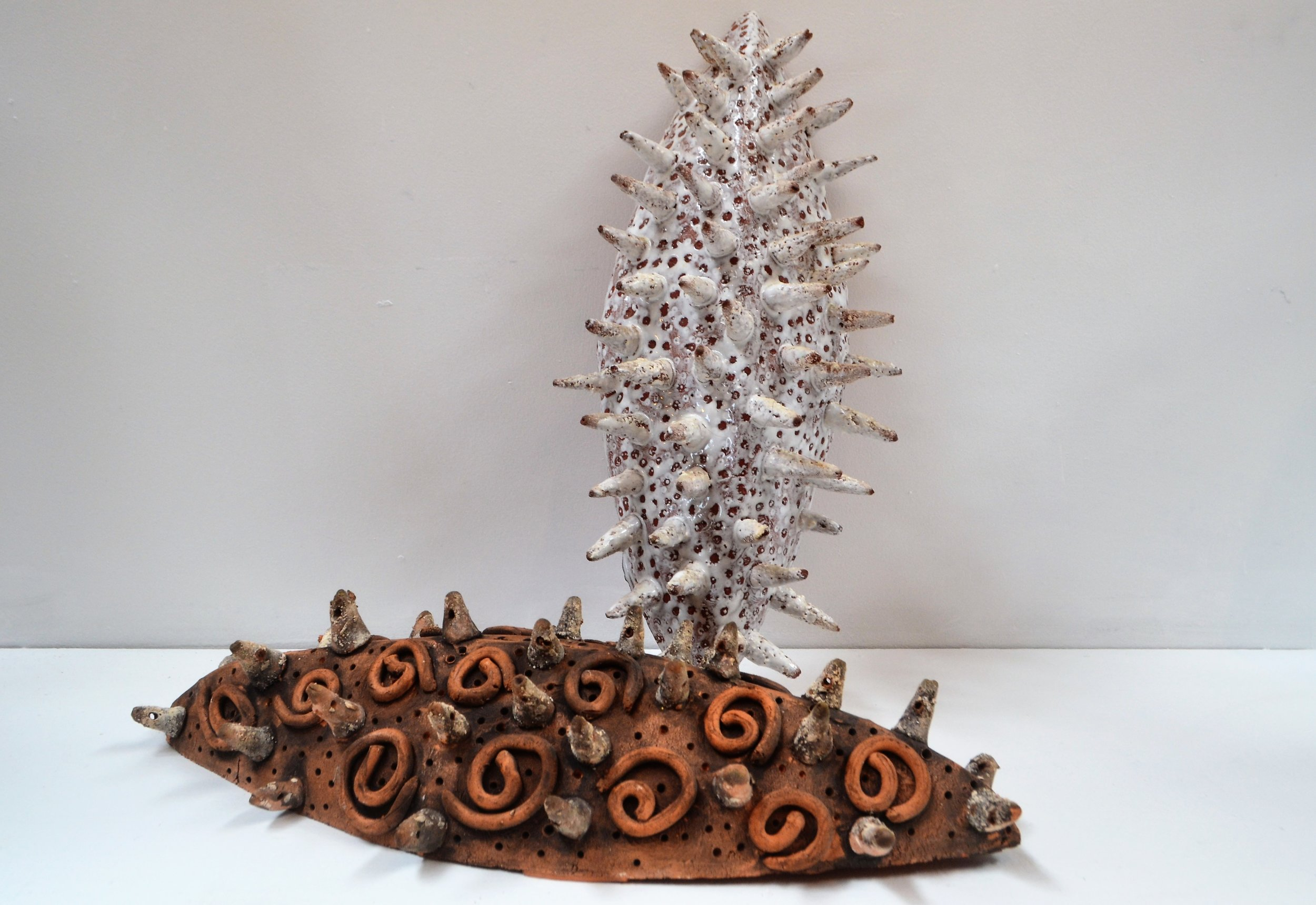 Feelers (duo)  Cherrie James, glazed and fired ceramic, can be hung flat-to-wall or lain down  $295.00
