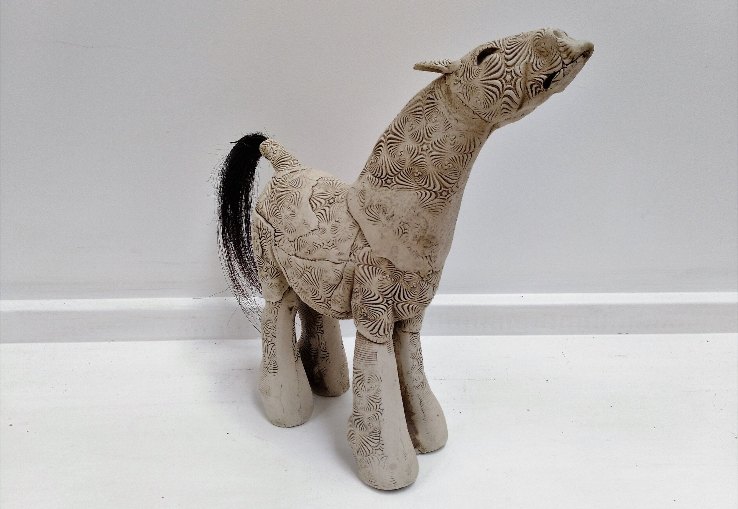 Horse with Horse Hair Tail  Fiona Tunnicliffe, hand-formed ceramic sculpture,  $310.00