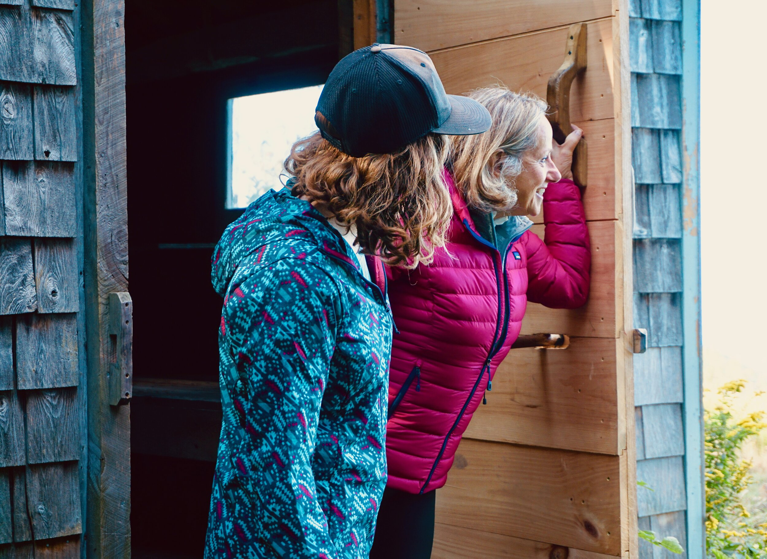 Left to Right: Women's Patagonia Icefall: Smolder Blue Houdini Jacket, Prana Vintage Blue Heather Foundation Long Sleeve Crew Neck (baselayer), and Patagonia Craft Pink Down Sweater