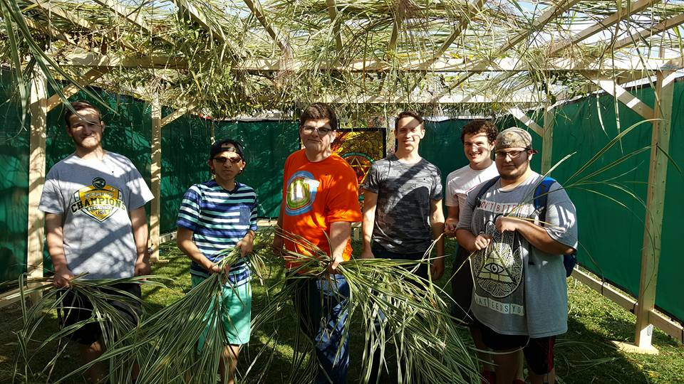 AEPi Brothers help assemble the Sukkah at Hillel!