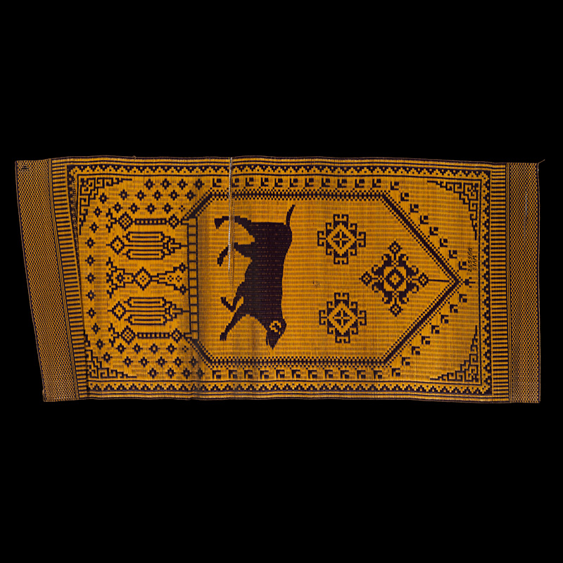 """Chantaboon"" Woven Reed Mat with Astrological Sign of the Dog Chanthaburi Province Gift from King Chulalongkorn to the Smithsonian Institution, 1904 188 x 86 cm Courtesy of the Smithsonian Institution, Department of Anthropology; E235968; Photo by Jim Di Loreto"