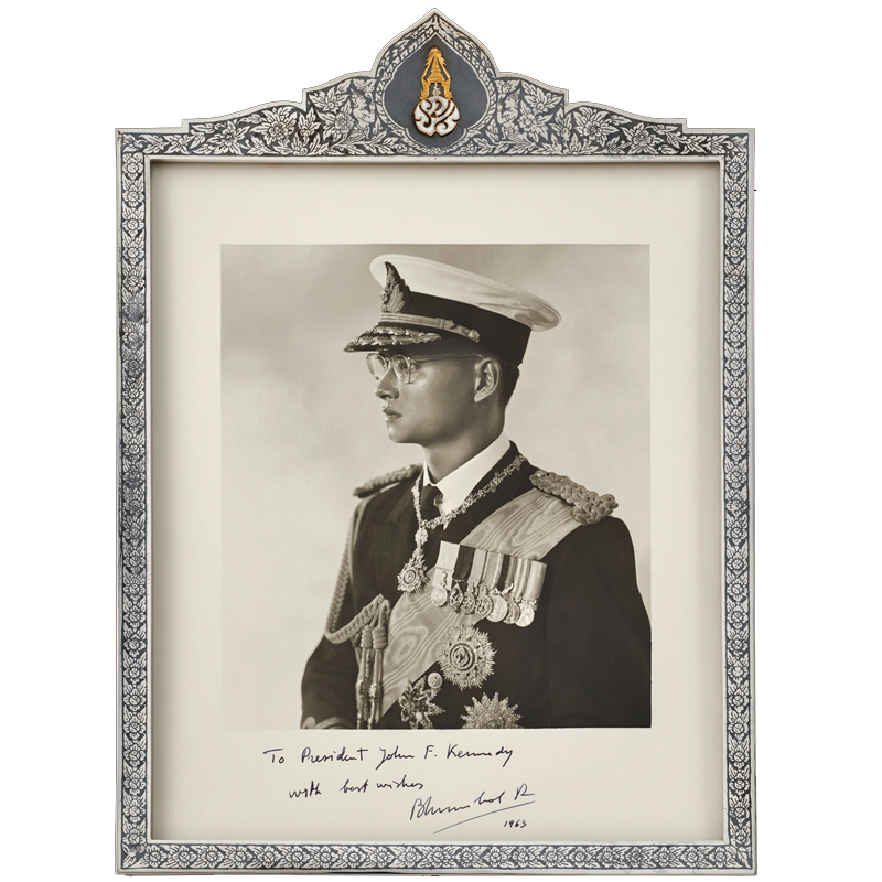 Portrait of King Bhumibol Adulyadej of Thailand in a Silver Niello Frame with Gold Royal Cypher Gift from King Bhumibol Adulyadej to President John F. Kennedy, 1963 38.1 x 26 cm Courtesy of the John F. Kennedy Presidential Library and Museum; MO 76.307