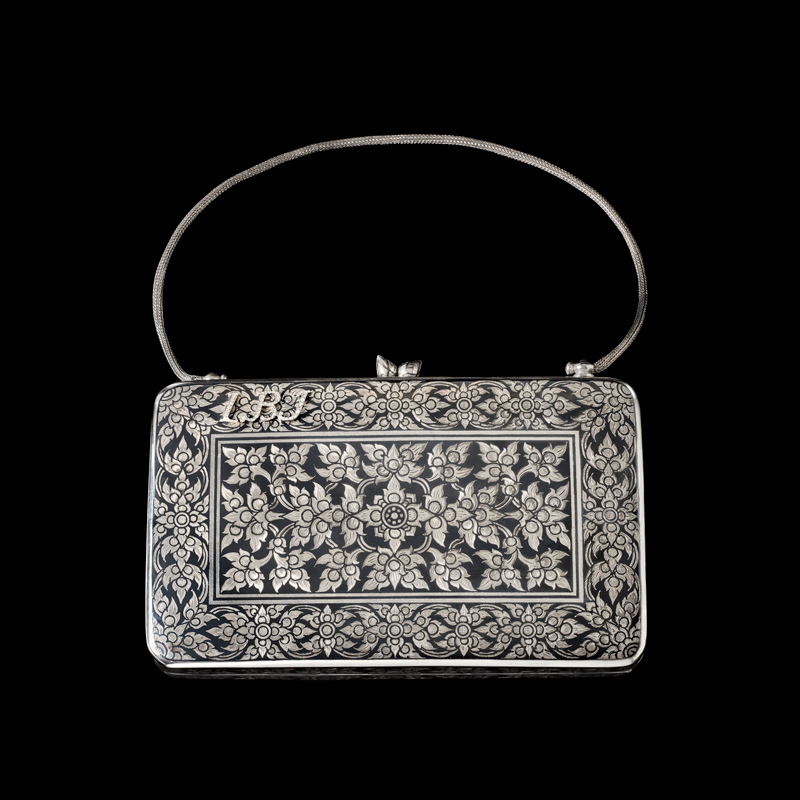 """Silver Niello Purse Embellished with Diamonds Gift from Queen Sirikit to First Lady Claudia """"Lady Bird"""" Johnson, 1966 12.1 x 17.7 x 3.6 cm Courtesy of the Lyndon B. Johnson Presidential Library and Museum; 1966.51.6"""