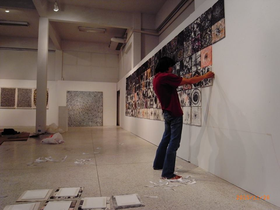 thai artist putting his collection together.jpg