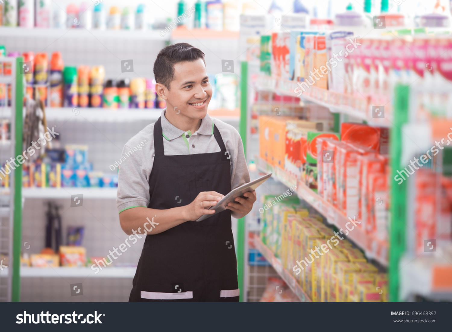 stock-photo-portrait-of-asian-male-staff-checking-the-product-with-tablet-pc-696468397.jpg