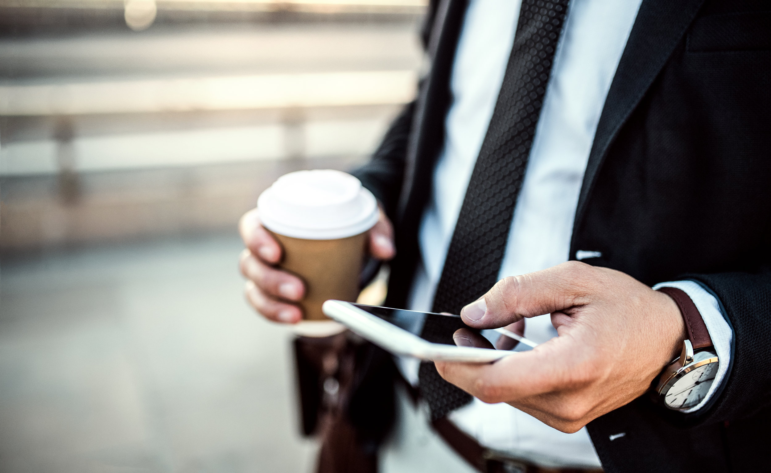 a-close-up-of-a-businessman-with-smartphone-and-89MRN2Z.jpg