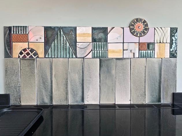 Kitchen tile frieze behind a range cooker.
