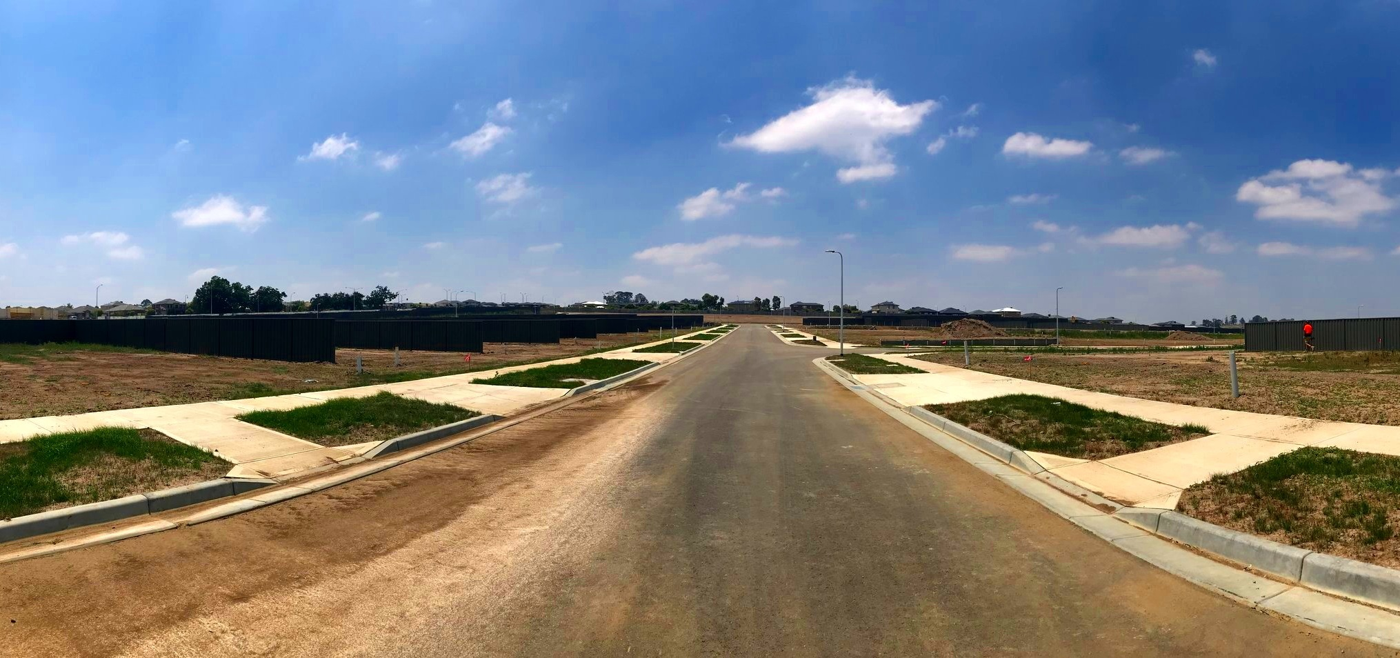 A glance up Amesbury way - 07/01/19The grass is starting to grow, whilst Amesbury Way receives its finishing touches. The last of Stage 2 fences are being erected.