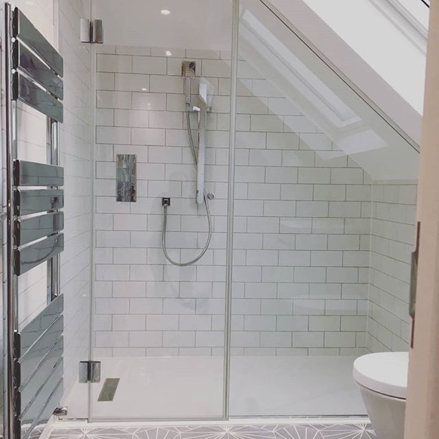 Glass shower screen and door, angled to fit a sloping ceiling.  We can custom make glass shower screens to fit even awkward spaces. Call or email to discuss your requirements.