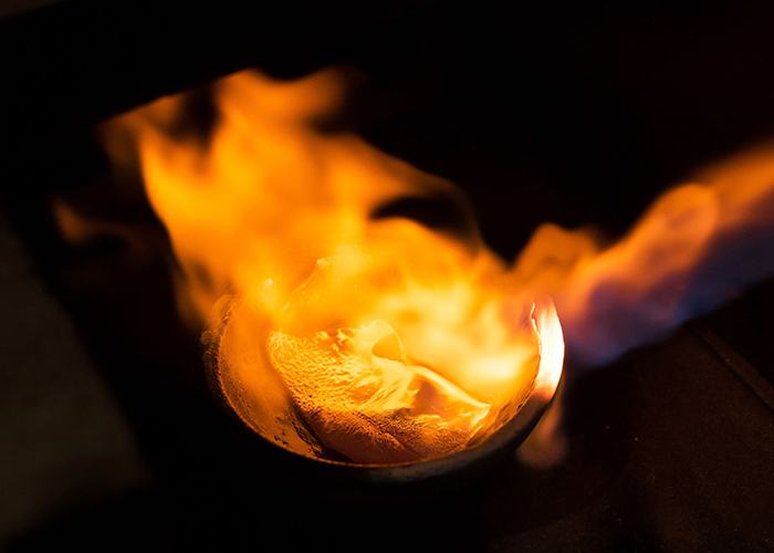 Melting gold to create our timeless Fairmined Ecological gold jewelry.