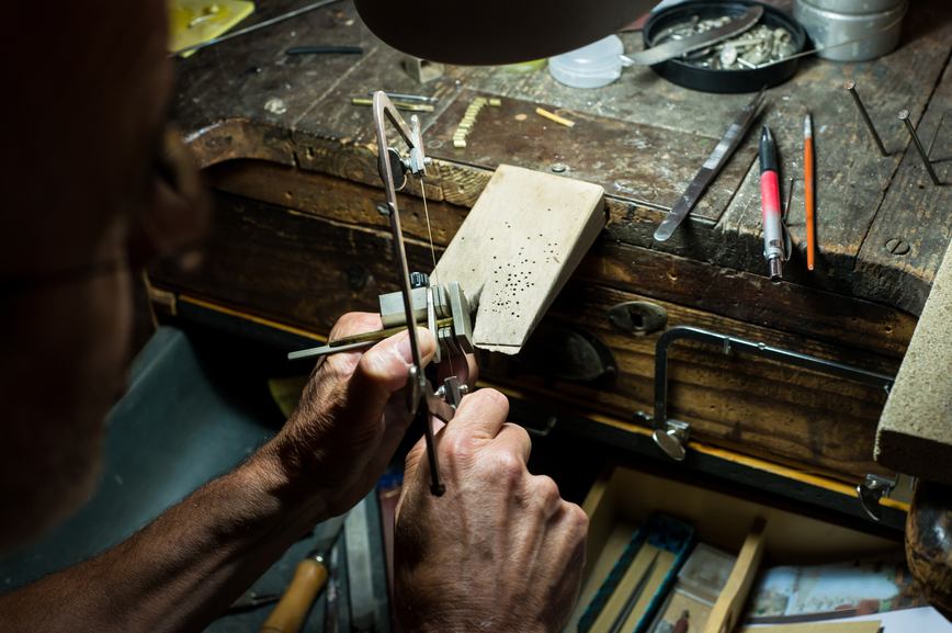 A Jeweler working on a Futura 18kt Fairmined Ecological gold model.