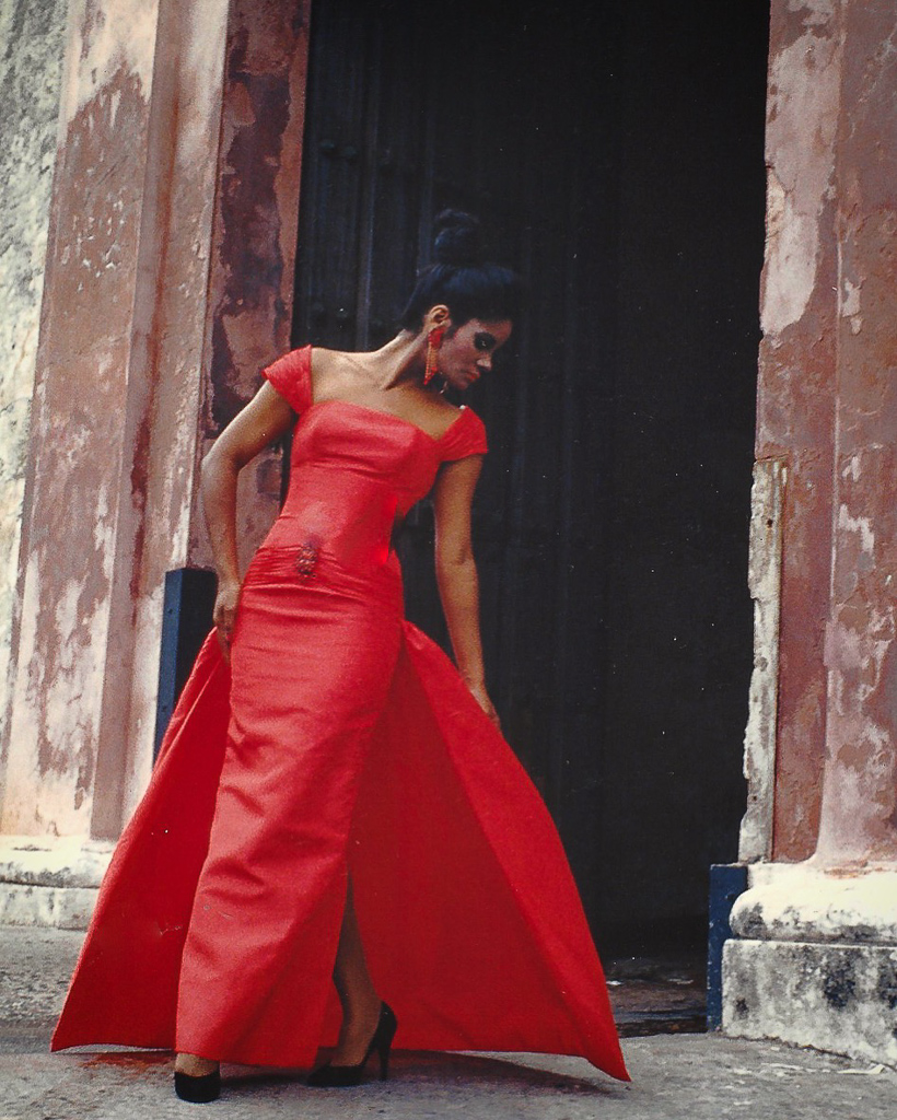 Carmen Salamán wears a dramatic red dress made by a young Harry Robles back in 1991.