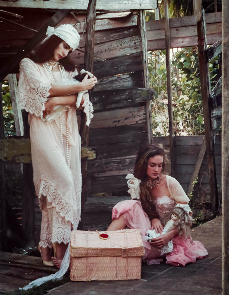 A very romantic look by designer David Antonio. Models Frances Torres and Jacqueline Franceschi were playing with old porcelain dolls in an abandoned shack. This pic is another one of my favorites. I love it's mood.