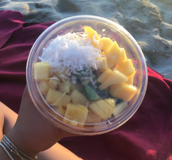 My friends and I watched the sunset every single day on the island. On this day in Honolulu, my girl Tricka (@wisdombodied) who lives in Waikiki took me to her go-to spot for the best açai bowl ever! This one had fresh pineapple, mango, and kiwi over shredded coconut, locally made granola, and an açai-banana base. It was the perfect cold sweet treat that accompanied an equally sweet view of magic hour on Waikiki beach.