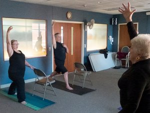 """University of Wisconsin Madison News - November 2, 2017 / By David TenenbaumStudy: Yoga Reduces Falls among the ElderlyYoga instructor Paul Mross, who taught yoga for the new study, shown here leading a class in Dodgeville, Wisconsin. """"When it comes to fall prevention, we want to help you stand strong, but it's not just standing,"""" he says. """"We move in our life, we are reaching, doing whatever it is we need to function, and yoga helps us remain stable then, too."""""""