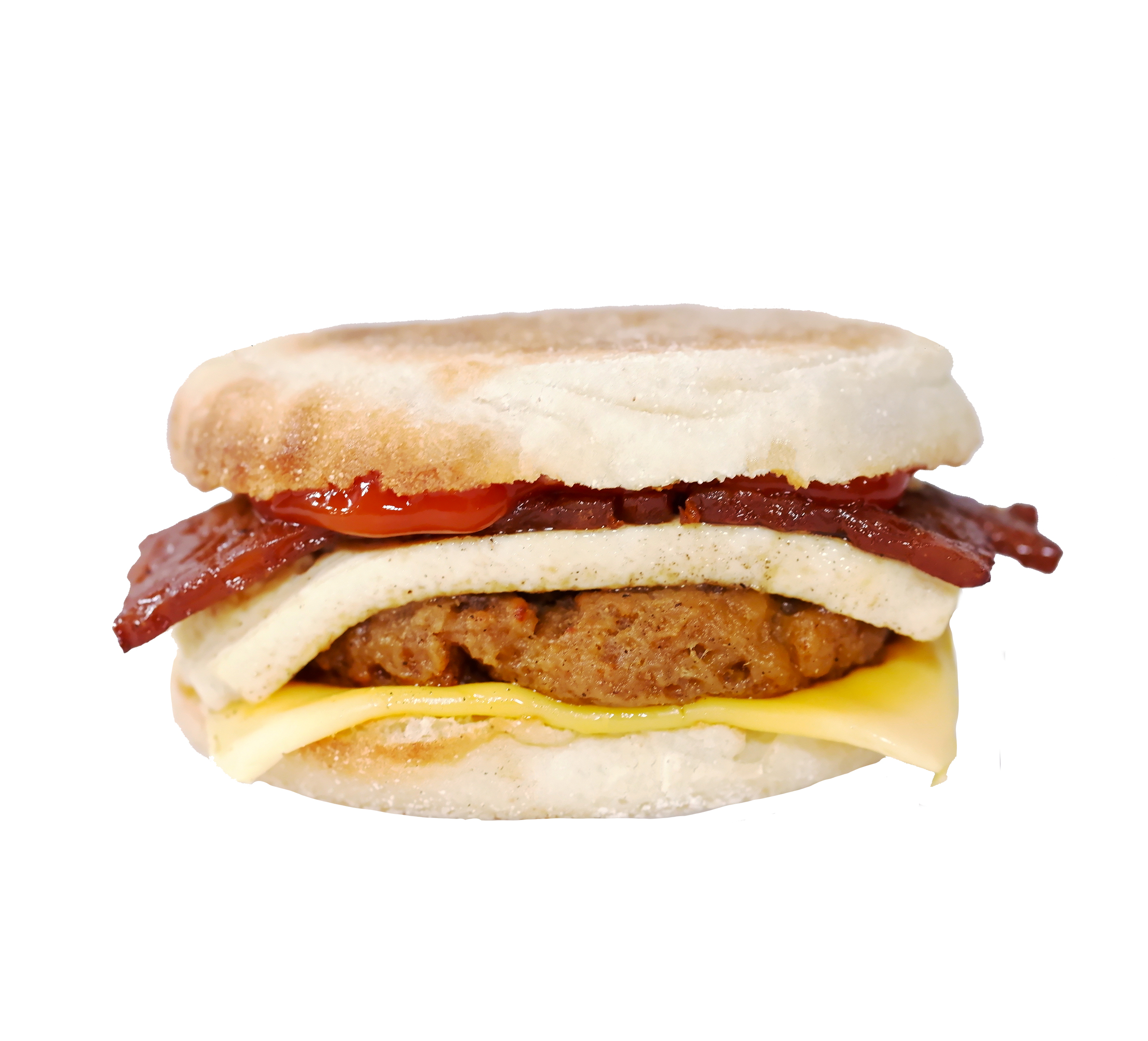 faconator - This hearty sandwich features our house-made breakfast 'sausage', bacUn, and a hand cut tofu 'egg'. Served on your choice of plain or whole wheat English muffin with a slice of dairy-free American style cheddar cheese and a drizzle of ketchup on top.