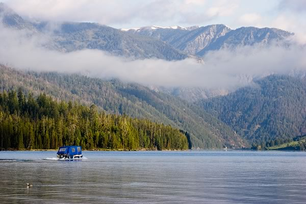 Your pontoon shuttle across the lake to meet your fishing guide for the day.