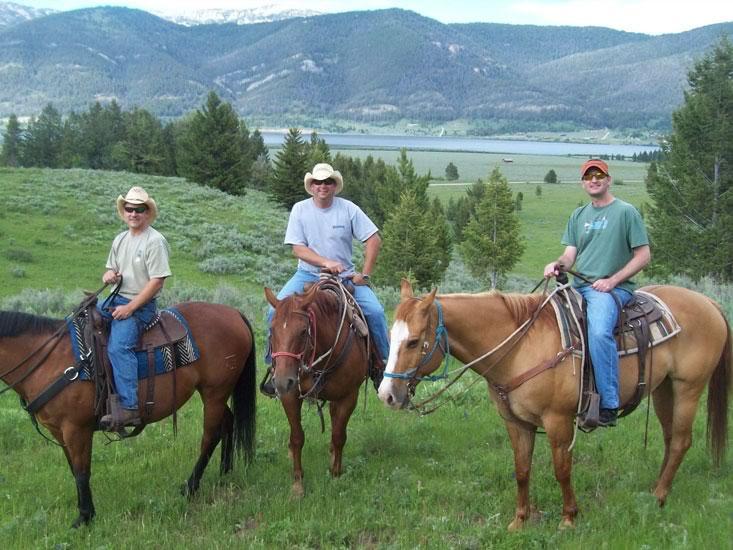 firehole-ranch-guests-horseback.jpg