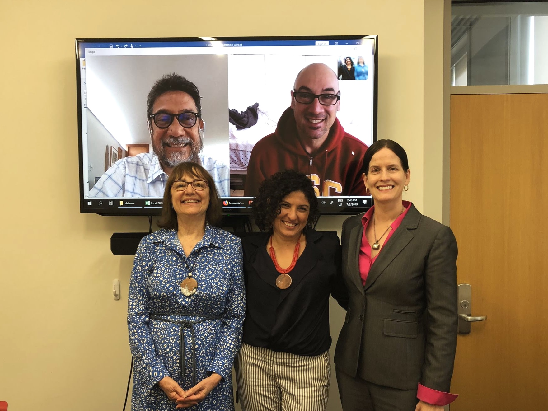 Dr. Fernanda Rosa with Dr Levinson and Dr. DeNardis; Dr. Almeida and Dr. Sinnreich on screen.