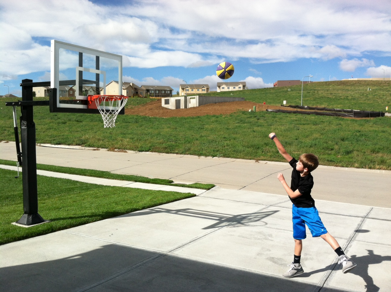 a-young-boy-shooting-a-basket-at-pro-dunk-silver-basketball-1598-source.jpg
