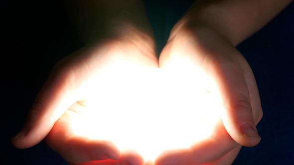 Boy Holding Light In Her Hands.jpg