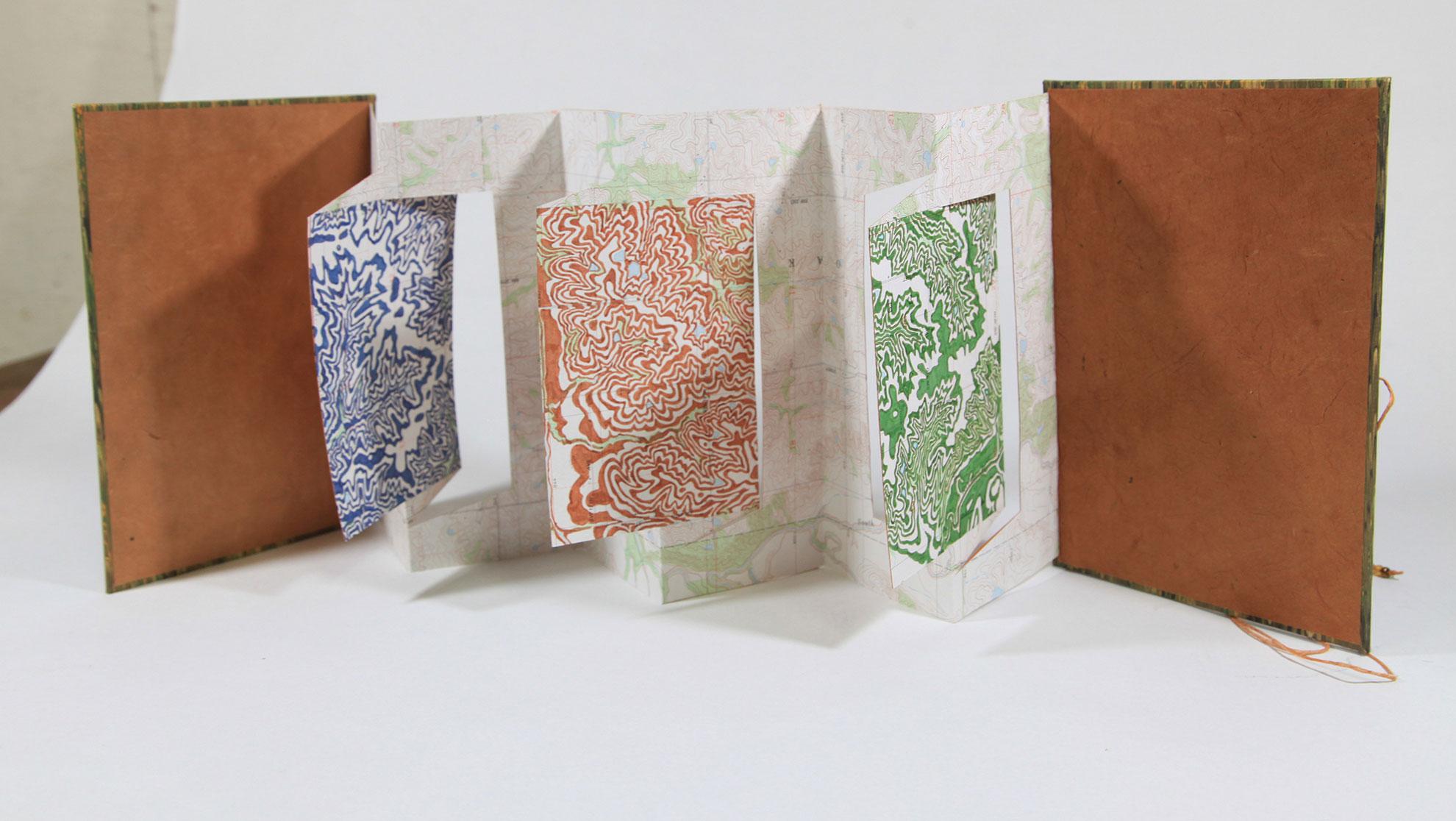Janet Reynolds, Op Art Map, Repurposed Map, Ink, Handmade Paper, 2017, $475, Houston, TX