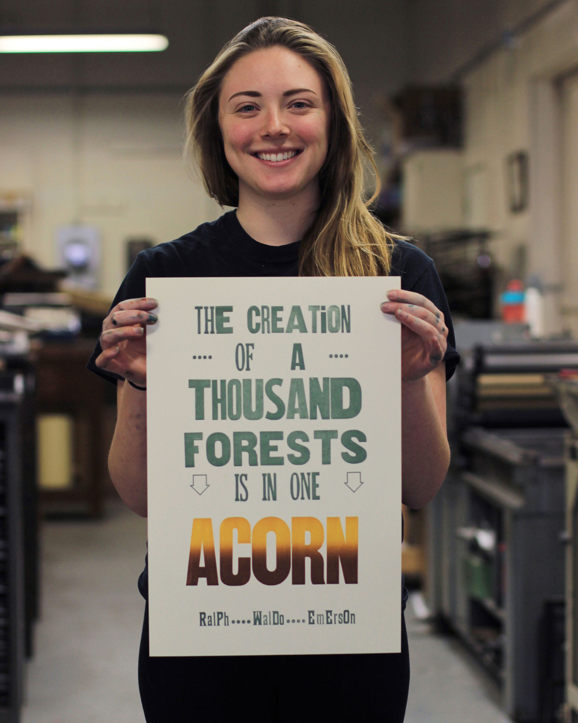 Meredith with a poster created during her internship at the KBAC