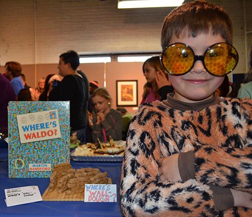 """Simon with his book """"Where's 'Wall-Dough'"""""""