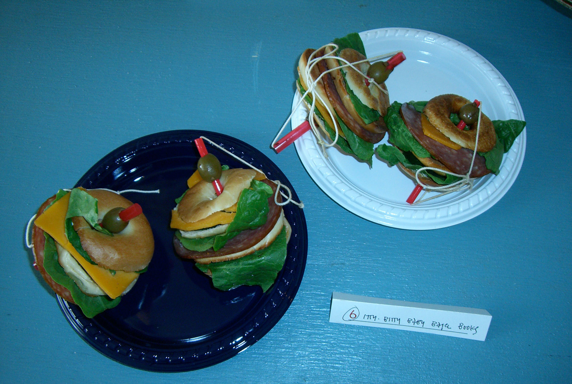 """""""Itty-Bitty Baby Bagel Books"""" by Eve Reid; 2006 Edible Book Festival entry"""