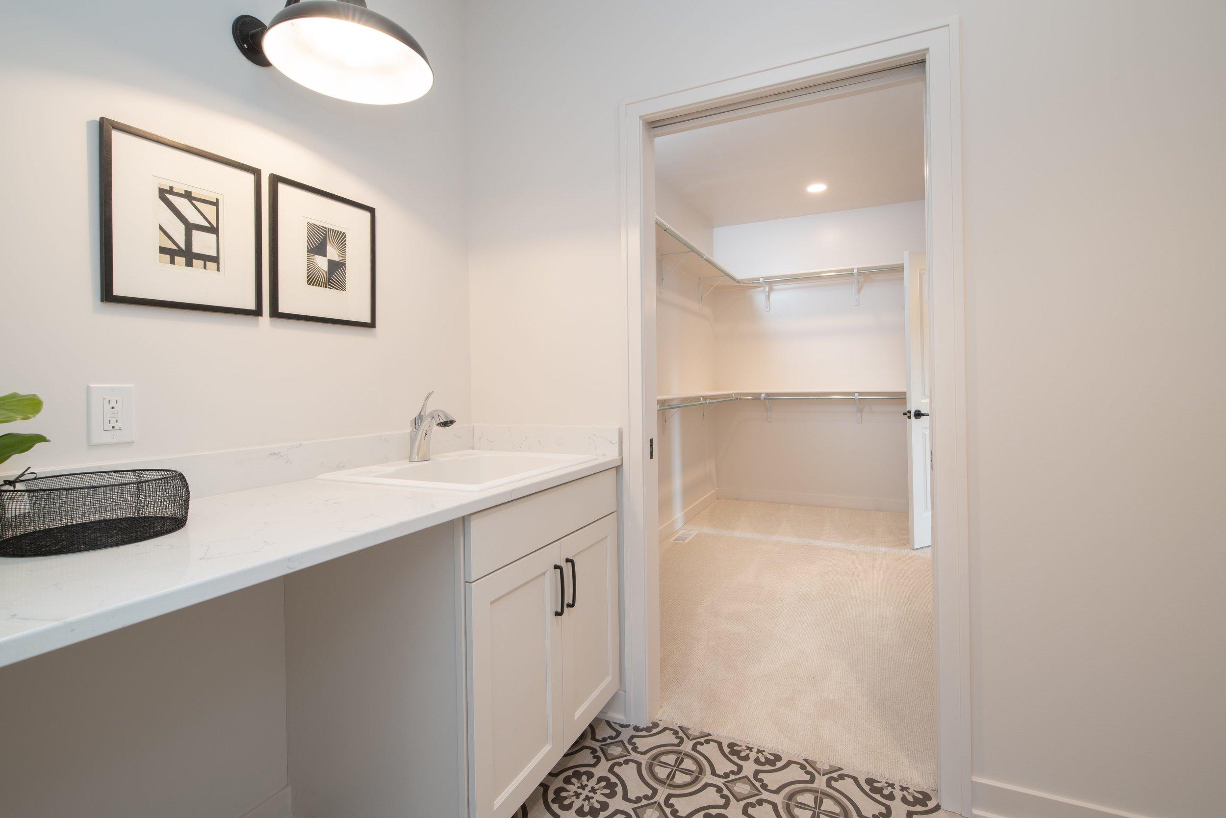 WW-04-110_Foxglove_Laundry_counter sink & walk-in closet-min.jpg