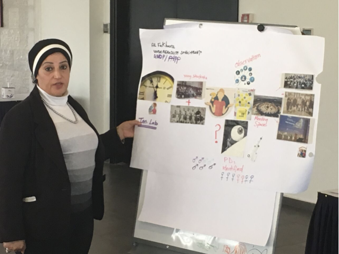 UNDP project manager Maha Abusamra presenting the Al Fakhoora project