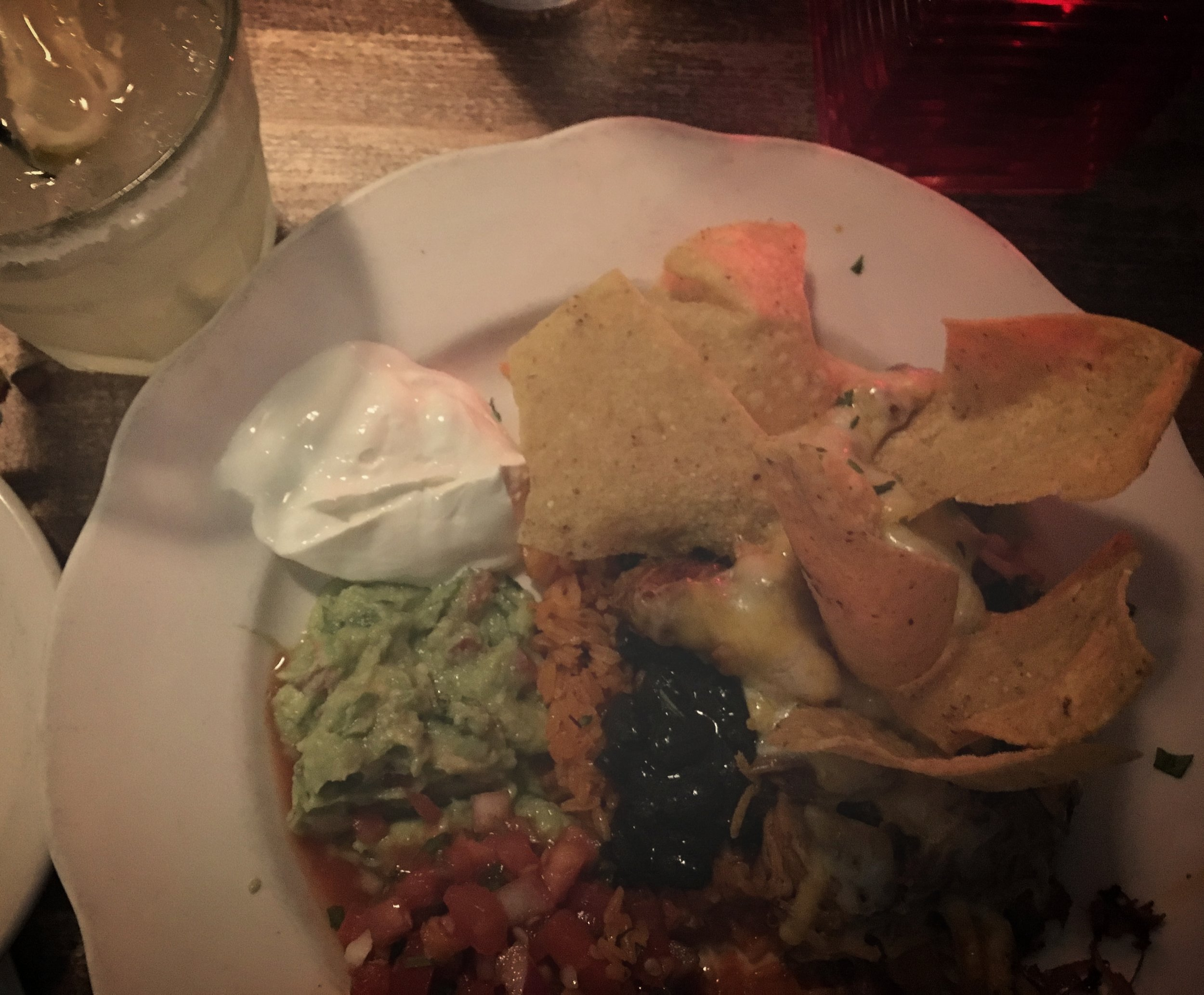 This is the El Plato Grande Dish  I got it with Chicken, and it comes with chips sour cream, beans, rice, cheese and guacamole