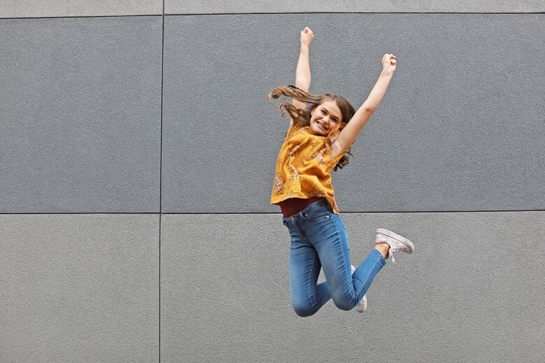 Sneakers and jeans means we get to JUMP! Love this girl!