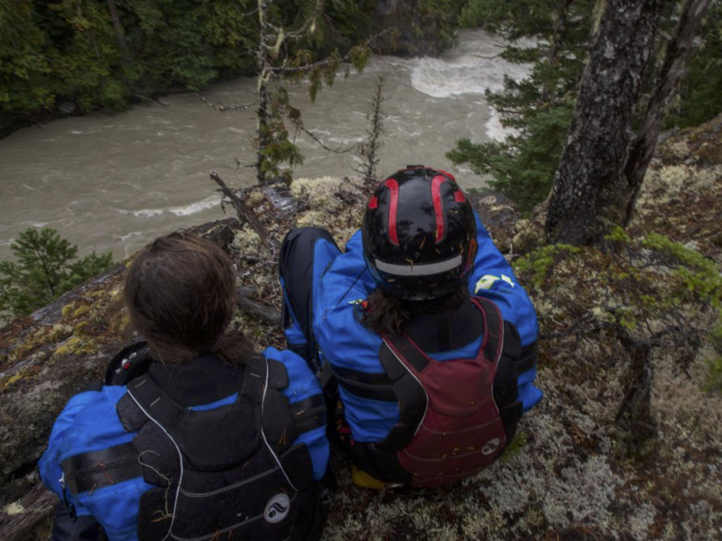 Jordan Slaughter and Jo Kemper scouting one of the top rapids in the Klinaklini Canyon as water levels continue to rise. Photo: Maranda Stopol.