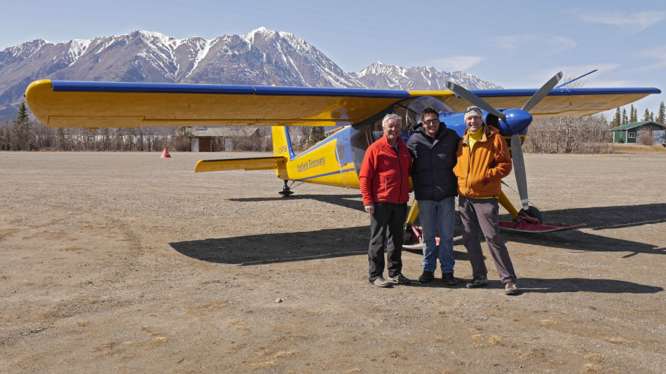 From left, Chic Scott, pilot Yukon pilot Tom Bradley and Glen Crawford relax after a three-hour flight around the Yukon's Saint Elias Mountains to capture film footage. Photo: Glen Crawford.