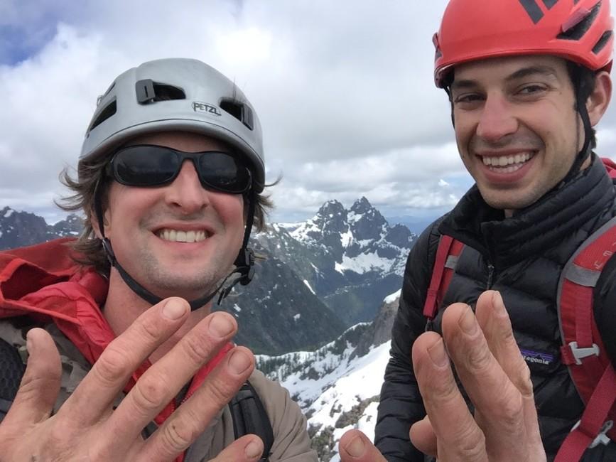 June 4th, 2017 (L-R) Stefan Gessinger and Evan Devault on Redwall, the final peak on their full Mackenzie Range traverse. Photo by Evan Devault.