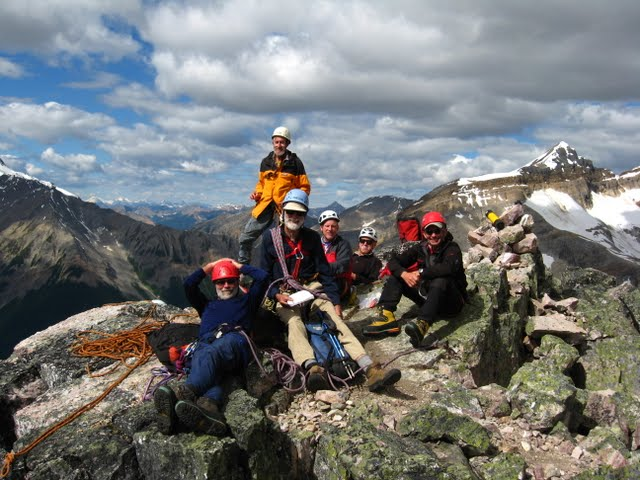 The 2011 team soaking in summit sunshine, Mt. Odaray in the background. Photo by Dave McCormick.