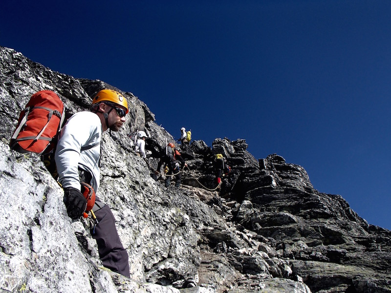 Safety in numbers allows quick work through roped technical terrain. Photo by Amber McMinn.