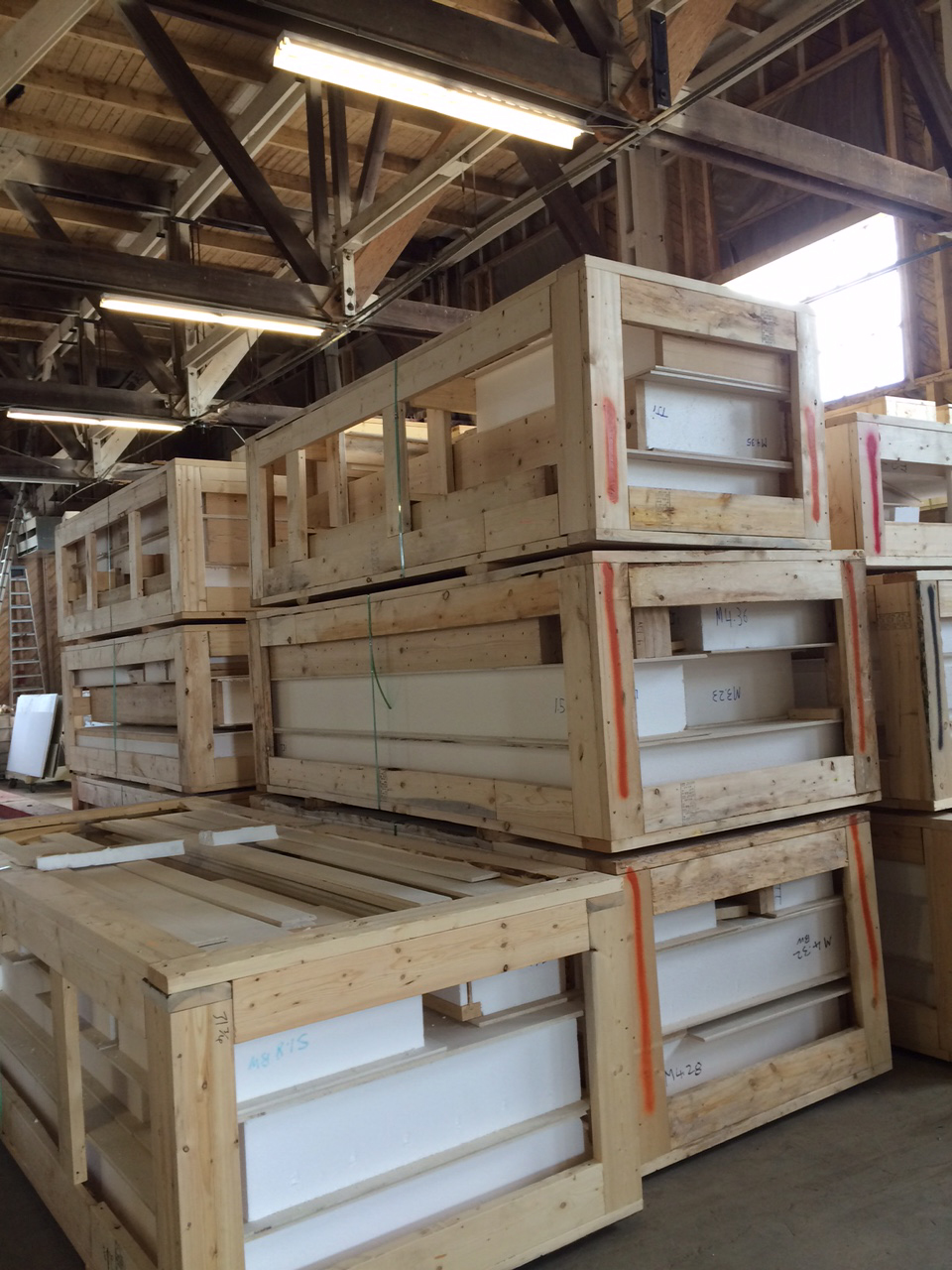 Structurally Insulated Panels (SIPs) waiting to head into the mountains. Photo by Rick Gardiner.